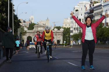 People running and cycling through Madrid's Puerta de Alcala on the first day since Spain eased the Covid-19 lockdown measures to allow exercise.