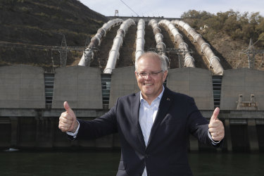 Prime Minister Scott Morrison poses for photos during a visit to the Snowy Hyrdo Tumut 3 power station in Talbingo, NSW. The site is near where the additional power lines will be needed to connect the pumped hydro plant to the grid.