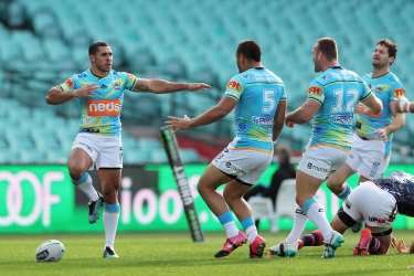 Jamal Fogarty celebrates a try against the Roosters.