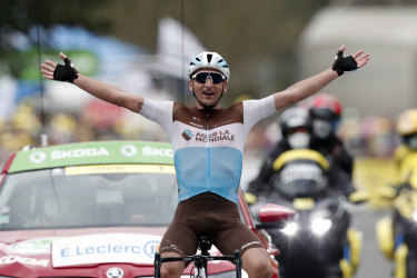 France's Nans Peters celebrates as he crosses the finish line to win the eighth stage of the Tour de France.