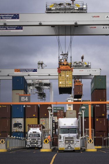 A computer-controlled crane loads a truck at the Victorian International Container Terminal at the Port of Melbourne.