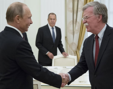 Vladimir Putin and U.S. National security adviser John Bolton greet each other in Moscow last week.