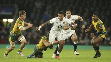 England's Manu Tuilagi powers through the defence.
