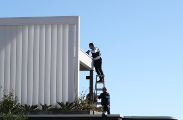 Police search the gutters of John Ibrahim's Dover Heights home in 2017.