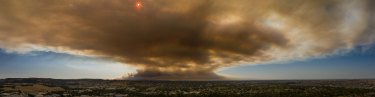 The smoke cloud over townships south-east of Melbourne, captured from a drone looking east from Pakenham.
