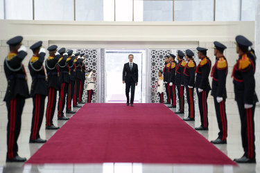 Syrian President Bashar Assad makes a grand entrance before his swearing in.