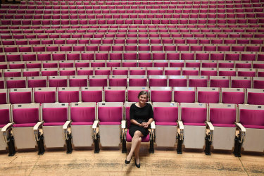 Sydney Opera House CEO Louise Herron sits in the Concert Hall of the Sydney Opera House, in seats by architect John Rourke.