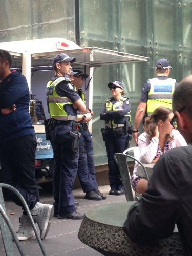Police were out in force at Brunetti's cafe in City Square on Monday morning.
