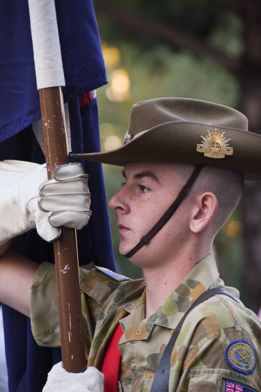 An Australian Army cadet holds the flagpole during the Anzac Day March.