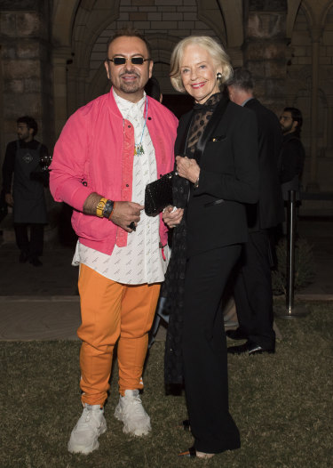 Napoleon Perdis in his technicolour finery, with Dame Quentin Bryce in Brisbane on Tuesday.