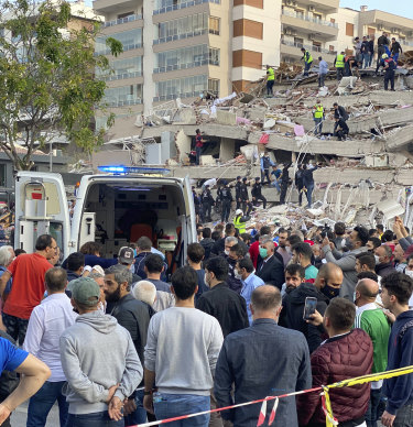 Rescue workers were attempting to find survivors in the rubble of a collapsed building in Izmir.