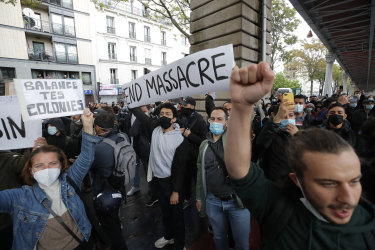 Demonstrators in Paris hold banners during a banned protest in support of Palestinians on Saturday.