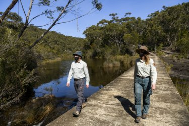 Brendon Neilly, Area Manager of the Royal National Park and Jodie McGill, a ranger for the Heathcote National Park, during a visit this week to the Woronora River within the parks estate.