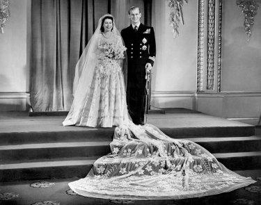 Princess Elizabeth, now Britain's Queen Elizabeth II, and Lieutenant Philip Mountbatten, now Prince Philip, at Buckingham Palace after their wedding on November 20, 1947.