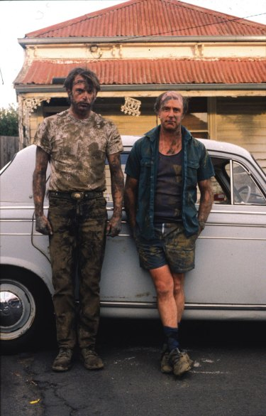 Clarke, right, as the grave digger Dave, with Sam Neill in