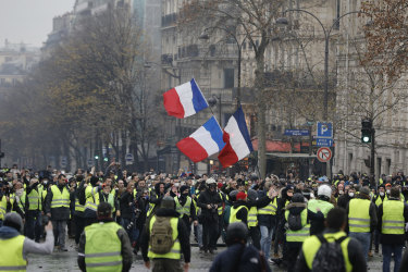 Demonstrators march near the Champs-Elysees.