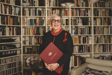 Marriage celebrant Judy Aulich, in front of the bookshelves in her living room where she often marries her clients.