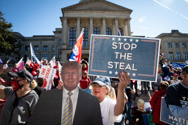 """Demonstrators gather during a """"Stop The Steal"""" rally outside of the Georgia State Capitol in Atlanta on Saturday."""