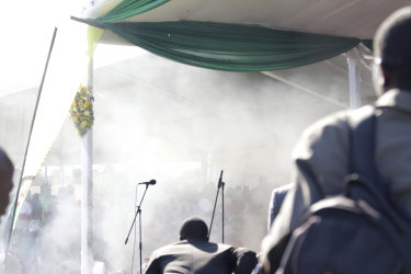 Smoke fills the stage at the rally.