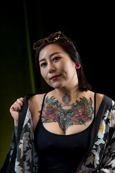 The Age, News 18/11/2016, picture by Justin McManus. Tattoo Convention at the Melbourne Exhibtion centre. People and their favorite tattoo. Ludan Jiang and tatto of her cat.