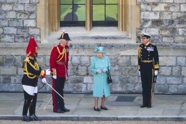 Queen Elizabeth II attends a small ceremony to mark her official birthday at Windsor Castle.