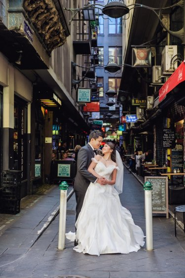DeGraves Street provides a scenic backdrop for Su San and Augustine.