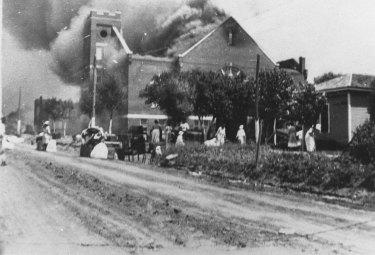 The University of Tulsa, The Mt. Zion Baptist Church burns in Tulsa, Okla. during the Tulsa Race Massacre of June 1, 1921.