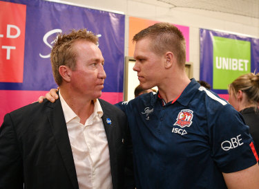 Here, have mine ... Roosters coach Trent Robinson gave forward Lindsay Collins his premiership ring after he was omitted from the 17-man team at the last minute.