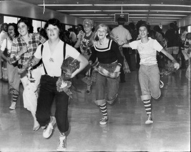 More than 200 screaming girls stampeded at Sydney Airport when the Bay City Rollers arrived in 1975