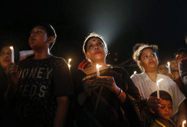 Bangladeshis light candles and sing songs as they pay tribute to those killed in the attack at a cafe in Bangladesh blamed on  Jama'atul Mujahideen Bangladesh in 2016.