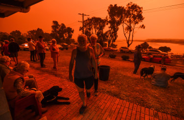 Locals in Mallacoota in January as fires devastated the region over summer.