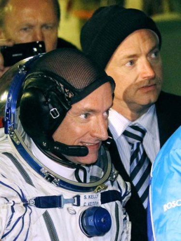 Scott Kelly, a crew member of the mission to the International Space Station, left, and his brother, Mark Kelly, also an astronaut.
