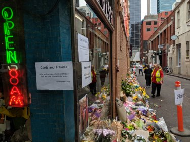 Notes are pinned underneath the battered brass 66 street number of Pellegrini's, which reopened on Tuesday after owner Sisto Malaspina was killed in an attack on Bourke Street.