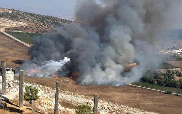 Smoke rises from Israeli army shells that landed in the southern Lebanese border village of Maroun Al-Ras, Lebanon.