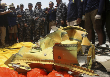 Navy personnel gather around debris recovered from the sea where the Lion Air jet is believed to have crashed in the waters of Tanjung Karawang, Indonesia, on Thursday.