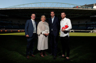 AFLPA chief executive Paul Marsh, Telstra's Joe Pollard, AFL chief executive Gil McLachlan and Sam Docherty, Carlton Football Club player and AFL Players Association Vice President