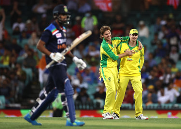 Adam Zampa and Steve Smith combine for the wicket of KL Rahul.