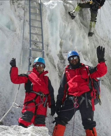 Dinesh and Tarakeshwari Rathod in their red gear on Everest.