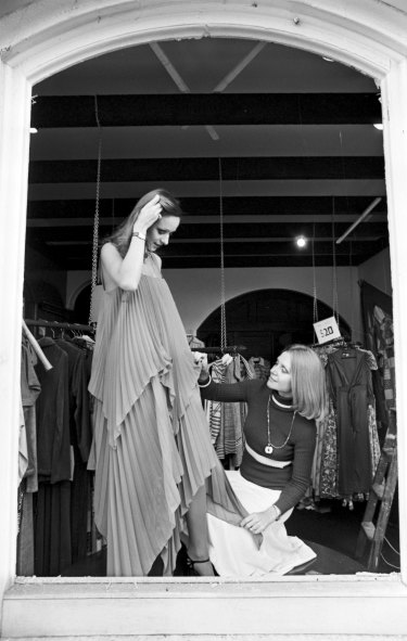 Carla Zampatti dresses a model at her store in Surry Hills, Sydney, July 1975.