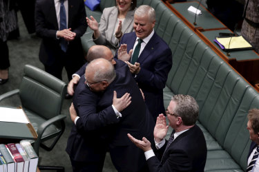Treasurer Josh Frydenberg is congratulated by Prime Minister Scott Morrison after delivering the Budget speech in the House of Representatives at Parliament House in Canberra on Tuesday 2 April 2019.