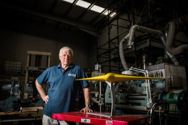 Underwater inventor Ron Allum with a model of the Sun Ray glider.