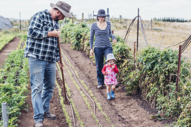 John Carroll, Christina Jagusiak and their daughter Maya Carroll on their Braidwood farm