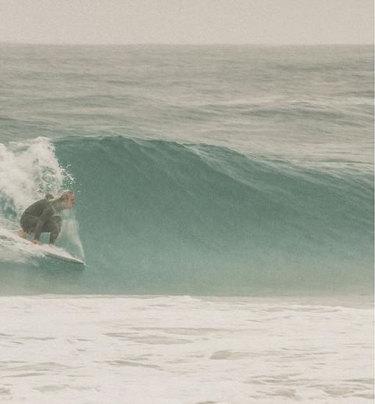 Tom Walker surfing off a Perth beach.