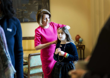 Nancy Pelosi fixes the hair of granddaughter Bella Kaufman in the Speaker's Office on Capitol Hill.