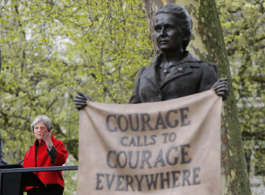 British Prime Minister Theresa May speaks after the unveiling a statue of Millicent Fawcett in Parliament Square, London.