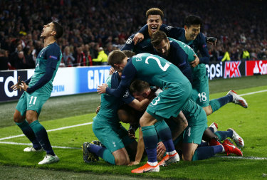 Triumphant: Tottenham players following Lucas Moura's third and decisive strike.