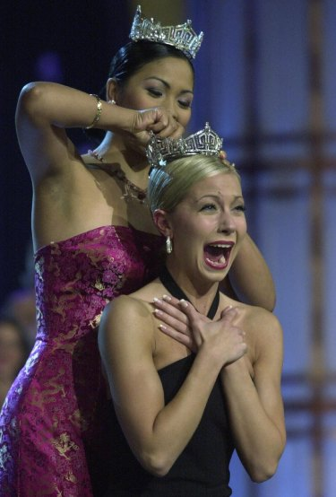 Miss America 2002, Katie Harman from Oregon (front), is crowned by Miss America 2001, Angela Perez Baraquio, at the Pageant in Atlantic City New Jersey, September 22, 2001.