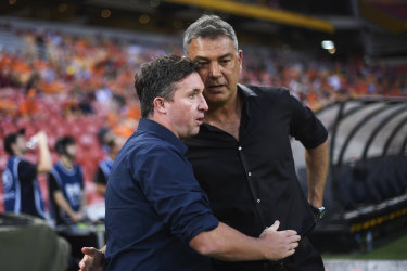 A happier moment: Brisbane Roar coach Robbie Fowler and Western United coach Mark Rudan.