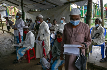 Refugees wait to be vaccinated in a Rohingya refugee camp in Cox's Bazar, Bangladesh.