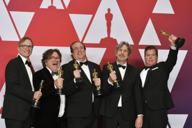 From left: Green Book producers Jim Burke, Charles B. Wessler, Nick Vallelonga, Peter Farrelly and Brian Currie pose with their Oscars after winning the award for best picture.